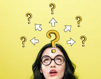 Big and small question marks with arrows with young woman stock images