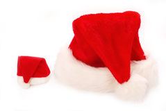Big and small santa hats Stock Images