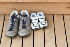 Big and small shoes on the back deck Stock Photo