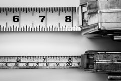 Big and small tape measure tools stock photos