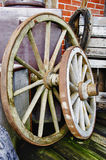 Big and small wagon wheels - HDR. Vintage - Big and small wagon wheels and old stuff in background Royalty Free Stock Photos