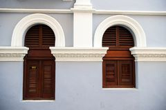 Big and small windows with wooden shutters in Puerto Rico. WindowBig and small with wooden shutters on grey wall background in San Juan, Puerto Rico. House with Royalty Free Stock Image