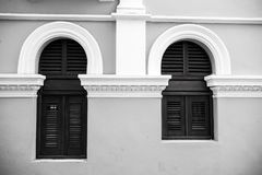 Big and small windows with wooden shutters in Puerto Rico. WindowBig and small with wooden shutters on grey wall background in San Juan, Puerto Rico. House with Royalty Free Stock Images