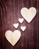 Big and small wooden hearts placed nicely Stock Photo