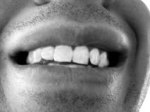 Big smile. Black and white smile - showing off some pearly whites royalty free stock photography