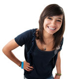 Big Smile. Cute hispanic teenage girl with braces and a big smile while hand on hip Royalty Free Stock Photography