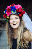 Big smile. Portrait of a beautiful young woman outdoors with flower turban on her head Royalty Free Stock Photo