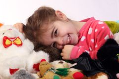 Big Smile. Little girl smiling while playing with her toys stock photography