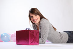 Big smile from happy woman with birthday present Royalty Free Stock Photo
