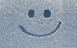 Smile on snow window. Big smile on snow window royalty free stock images