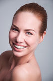 Big smile. Studio shot of young pretty happy woman girl with big sincere toothy smile, having white teeth, clear skin, fresh look, wearing braces on her lower Stock Photos