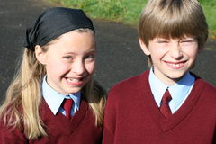 Big smile on the way to school. Brother and sister are going to irish school this morning in uniforms Stock Photography