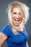 Big smile woman. Beautiful blond woman in big smile against the grey background Royalty Free Stock Image