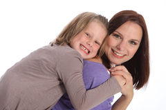 Big smiles mother and daughter piggy back fun royalty free stock photos