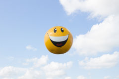 Big smiling air balloon. In sky Royalty Free Stock Photo