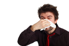 Big sneeze. Young man with cold virus blowing his nose Royalty Free Stock Photography