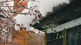 Big snow cap on the roof of the house on the corner of the house stock video footage