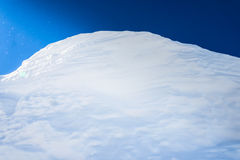 Big snow hummock of pure white snow made ​​wind Royalty Free Stock Photography