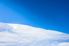 Big snow hummock of pure white snow made ​​wind Stock Image