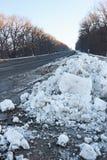 Big snow hummock on the roadside Stock Photography