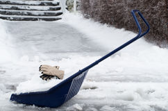 Big snow shovel full of heavy icy snow Royalty Free Stock Image