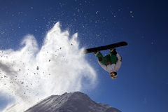 Big snowboard jump. With bright blue sky and snow stock photography
