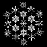 Big snowflake consisting of snowflakes. On black background Royalty Free Stock Photography