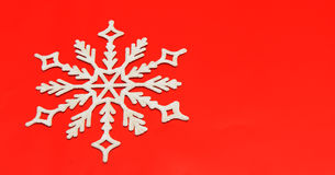 The big snowflake on a red background Stock Images