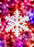 Big snowflake toy on colorful background Royalty Free Stock Photography