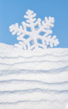 Big snowflake toy on sky background Royalty Free Stock Images
