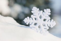Big snowflake toy in snowdrift Stock Photo