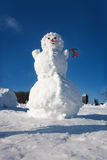 Big snowman on sky background Royalty Free Stock Photo