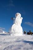 Big snowman on sky background Stock Photo