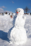Big snowman on sky background Royalty Free Stock Photo