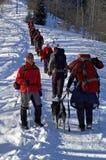 Big snowshoer group climbing Stock Photos