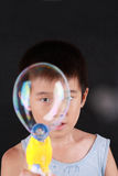 Big soap bubble and boy Stock Photography