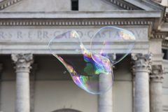 Big soap bubbles in front of the church Santa Maria Stock Photos