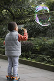 Boy blowing soapbubble Royalty Free Stock Photo
