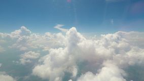 Big soft clouds floating in sky, interminable vast space, view from flying plane stock video