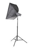 A big softbox isolated on a white background. A professional studio equipment. A black studio flash on a long tripod. Outbreak. Royalty Free Stock Photos
