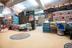 Big souvenir shop with carpets and shawls Royalty Free Stock Photography