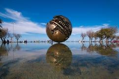 The big sphere of Arnaldo Pomodoro on the sea of Pesaro Stock Photography