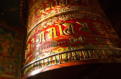 Big Spinning Tibetan Buddhist prayer wheel at Boudhanath stupa in Kathmandu Royalty Free Stock Image