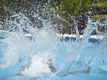 Big Splash. This is a stop action shot of a big splash in a pool stock image