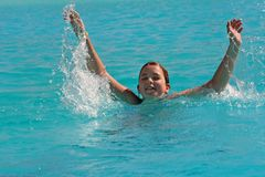 Big Splash. The girl plays in a swimming pool Royalty Free Stock Images