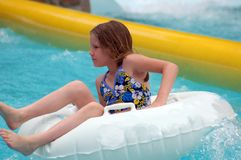 Big Splash. Girl at the bottom of waterslide stock images