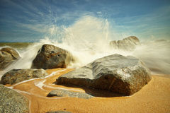 Big splash at Bari Kecil beach Stock Images
