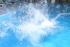 Big splash in pool Stock Images