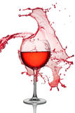Big splash of red wine in glass Royalty Free Stock Photo