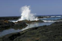 Big Splashing wave on the Big Island of Hawaii. A Big Splashing wave on the Big Island of Hawaii Royalty Free Stock Images